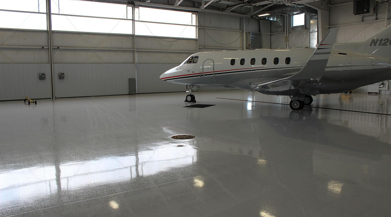 airplane hangar with plane